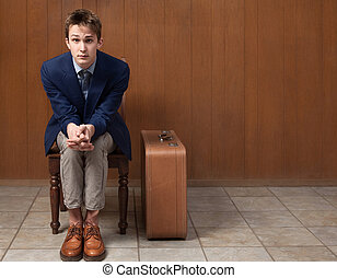 Serious Traveller - Serious young Caucasian traveller seated...