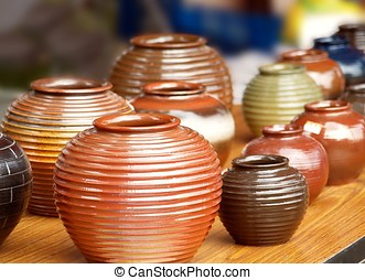 Handmade Pottery - Glazed ceramics are for sale at an...