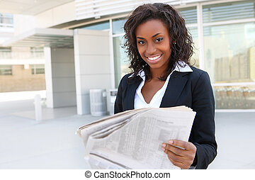 African Woman Reading Newspaper - African business woman...