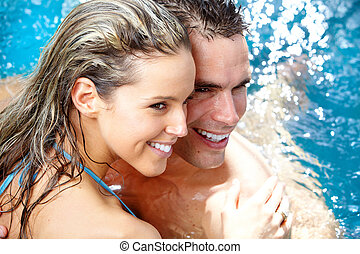 Couple - Young loving couple relaxing in the water Vacation...