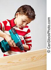 Boy drilling