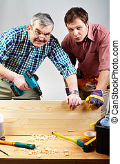 Two carpenters - Portrait of two carpenters in workshop
