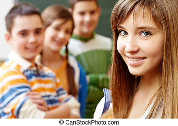 Pretty girl - Confident student looking at camera
