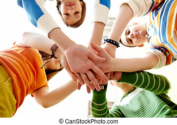 Companionship - Pile of hands of friends