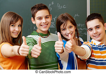 Classmates - Portrait of happy teens showing thumbs up