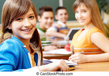 Pretty girl - Confident student looking at camera during...