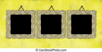 Three ancient empty frames hanging on the wall - Three...