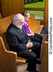 Senior White Man Woman Bowed Heads Praying Church