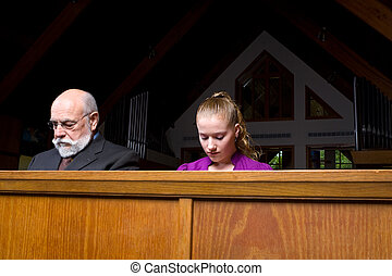 Senior Man Young Woman Sitting Head Bowed Praying Church Pew...