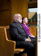 Older White Man and Younger Woman Sitting in Church Pew