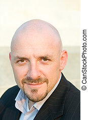 Head Shot 30's Bald Guy Goatee Looking at Camera - Head shot...