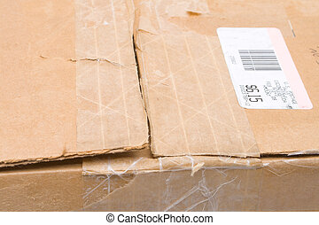 Worn Top Cardboard Package Box US Metered Mail - Close up of...