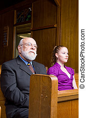 Senior White Man Young Woman Sitting in Church Pew