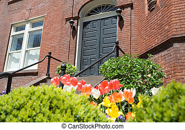 Brick Richardsonian Romanesque Row Home Spring