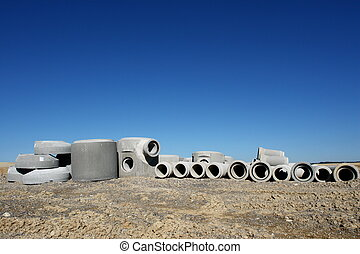 concrete pipes on a building site on a sunny day