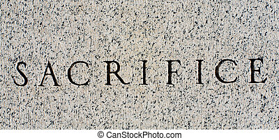 Word quot;Sacrificequot; Carved in Gray Granite Stone -...