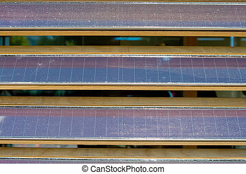 Row of Dusty Louvered Solar Panels