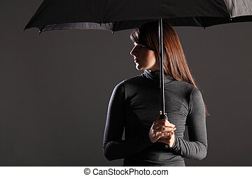 Protection and cover young woman under umbrella - Beautiful...