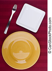 Table appointments - Ceramic plates for table on a red...