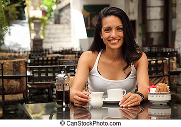 Girl having coffee in bistro - Beautiful smiling girl...