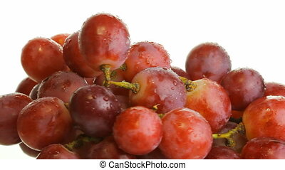 red grapes on a white