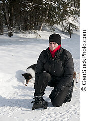 young woman with snowshoes