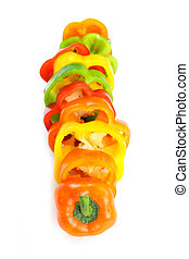Pepper Slices - Colorful pepper slices in a row on white...
