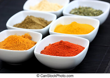 Spices of India - Different variety of spices on black mat