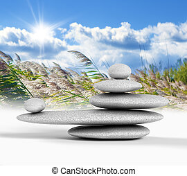 Zen concept with balanced rocks,sky and nature background
