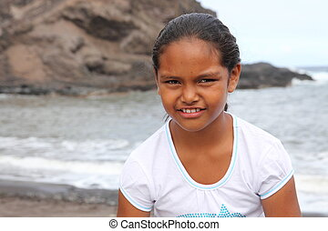 Girl on the beach with cute smile