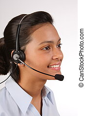 Pretty ethnic telephonist - Telephone support being provided...