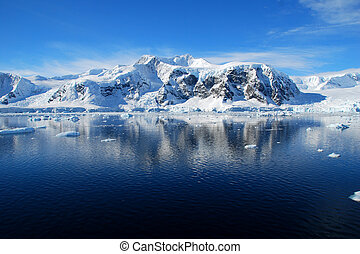 antarctic landscape, blue skies - blue sea and snowy...