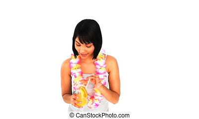 Asian woman sipping a cocktail in vacacion against a white...