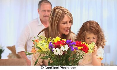 Grandparents with their grand daughter looking at a bunch of...