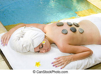 The young beautiful woman to Spa procedures in pool