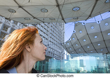 Paris, portrait of woman under Arch de la Defense