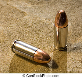 bullets on sandstone with a strong back light