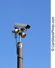 security camera - modern surveillance equipment mounted on a...