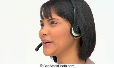 Asian woman speaking over the headset against a white...