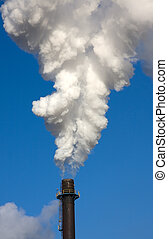 Smoke Stack - Factory chimney billowing smoke against a blue...