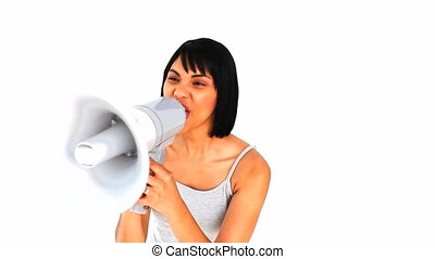 Asian woman shouting through a megaphone isolated on a white...