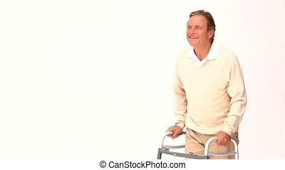 Mature man with a walker isolated on a white background