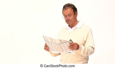 Retired man reading a newspaper against a white background