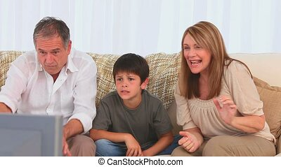 Family watching tv together in the living room