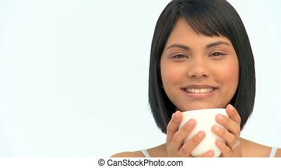 Cute asian woman drinking a coffee isolated on a white...