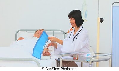 Nurse examining her patient at the hospital