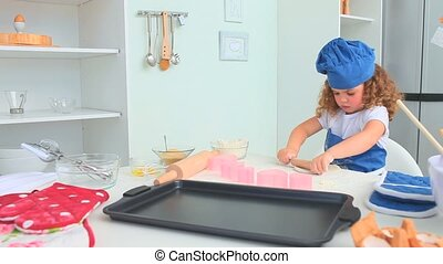 Cute child baking a cake in the kitchen