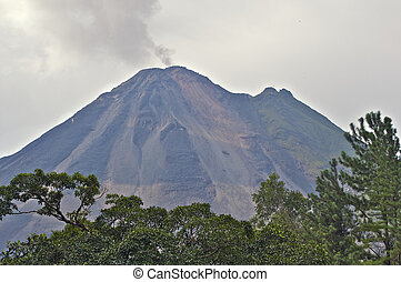 The Arenal Volcano at dusk. - The Arenal Volcano belching...