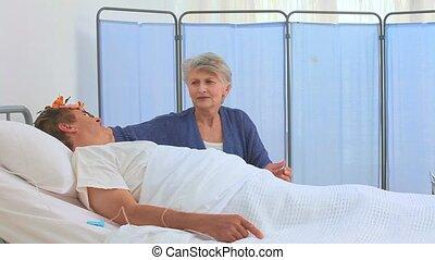 A patient having a visit of his nurse