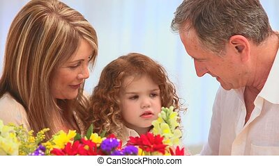 Cute family with a bunch of flowers